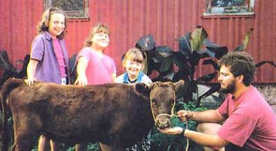 The Foley family of Indiana with a Dexter heifer. Photo Anna Poole from The Mother Earth News
