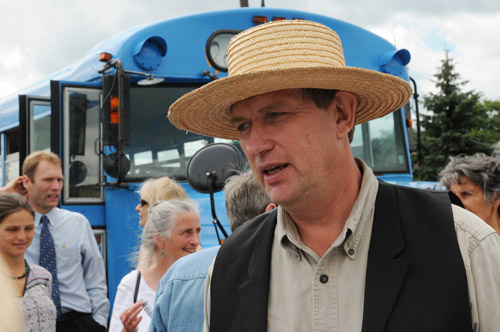 Raw milk farmer Michael Schmidt with supporters at the blue bus outside the Newmarket courthouse July 31, 2008
