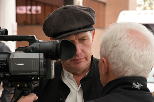 Farmer Michael Schmidt shares a moment with filmmaker Norman Lofts outside the courthouse in Newmarket Monday.