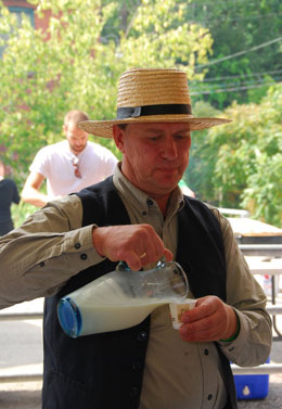 "Michael Schmidt pours a tall cool one at a picnic at Toronto's ""Brickworks"". PIF photo"