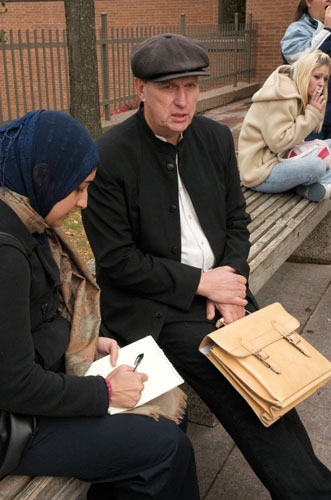 Noor Javed interviews Michael Schmidt for the Toronto Star outside the Newmarket courthouse,