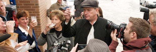 Michael Schmidt raises a toast of raw milk outside the Newmarket courthouse on October 20, 2008